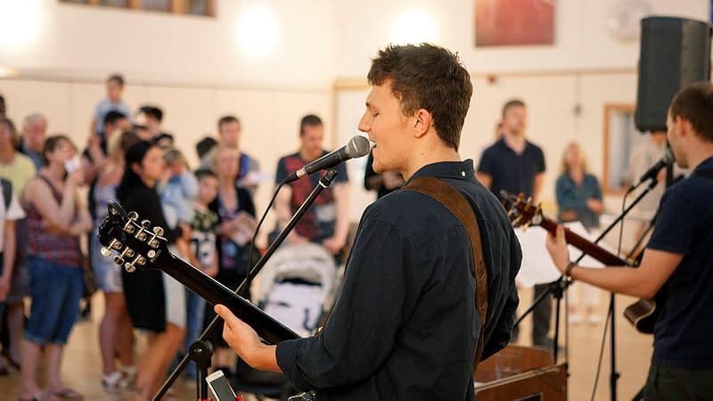 Music group leading worship