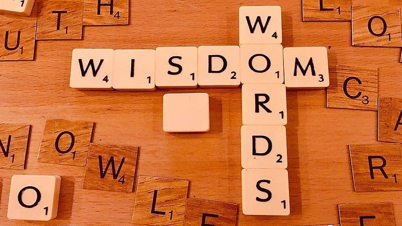 Scrabble letters spelling 'Wisdom Words'