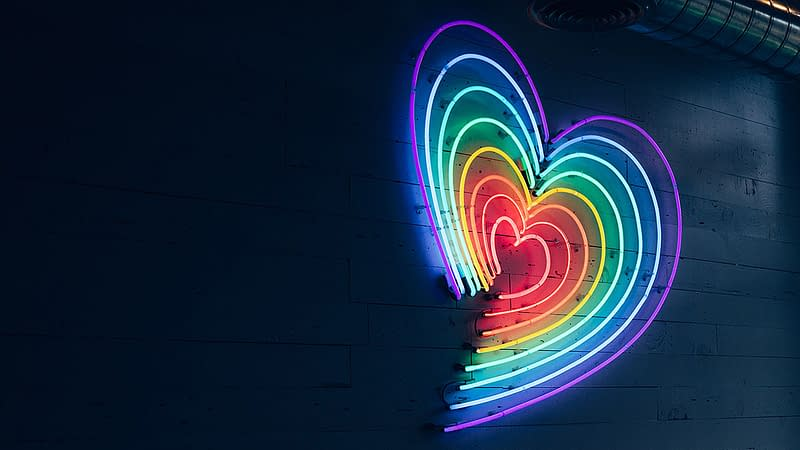Neon heart signage in rainbow colours