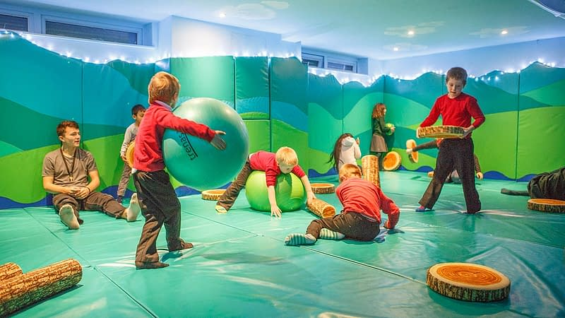 Children play in the bounce room