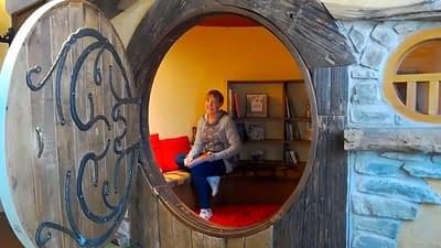 Storyteller sitting in the Hobbit house